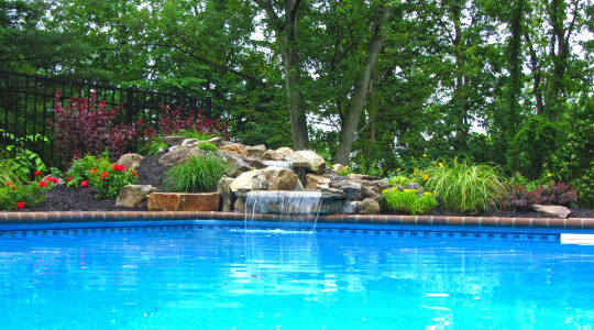 Natural Stone Swimming pool waterfall, Plantings, Paver Repair
